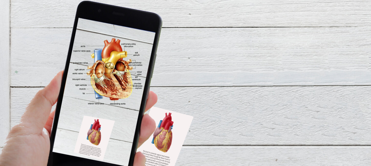 With the Augmented Reality Trends in Healthcare, details of a human heart is shown on screen with just a focusing it on a picture of heart